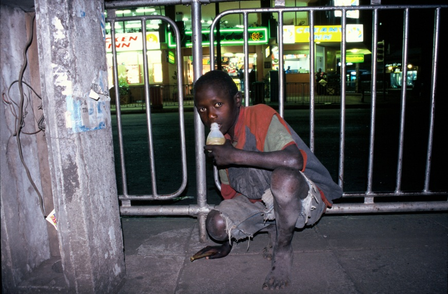 Street boy in Nairobi by Ofir Drori